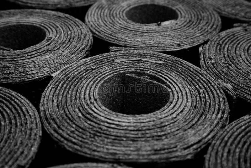 Roofing felt. Rolls of Bitumen. Closeup of Rolls of new black roofing felt or bitumen. Shallow depth off field stock images