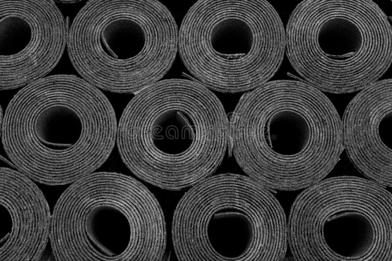 Roofing felt. Rolls of Bitumen. Closeup of Rolls of new black roofing felt or bitumen. Shallow depth off field royalty free stock image