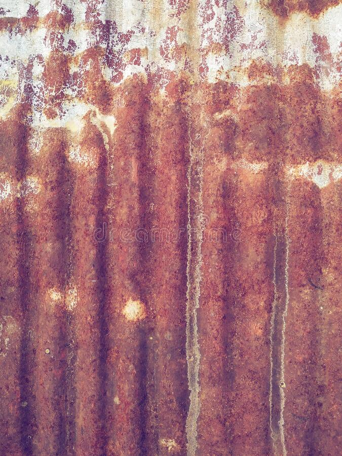 Roofing iron. Sheet of old, rusty, roofing iron. Photo taken by smartphone. White balance is incorrect stock photography