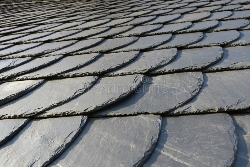 Roofing: pattern of gray slate on an antique roof lightend by th. E sun, Germany stock photos