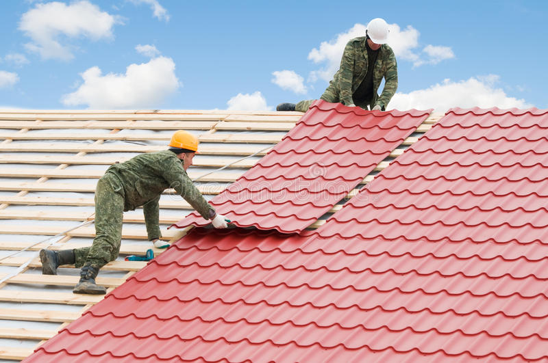 Roofing work with metal tile royalty free stock photography