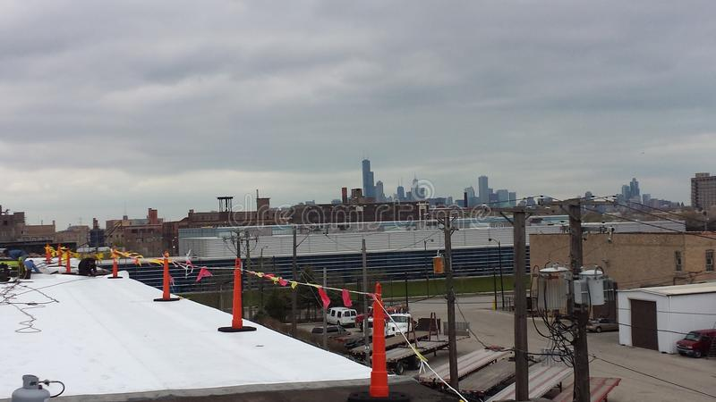 Roofing Work in progress, Commercial flat roof with safety flags in Chicago. EPDM Roofing Work on Commercial flat roof with safety flags in Chicago stock photo