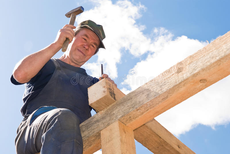 Download Roofing works with hammer stock photo. Image of tool - 15906642