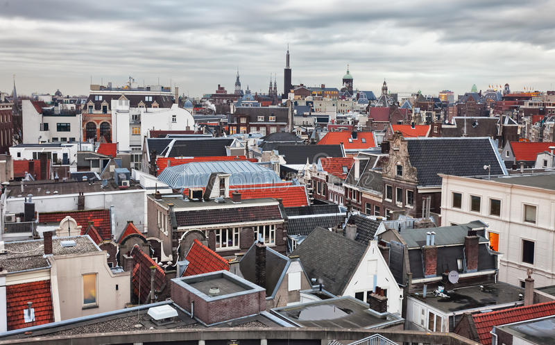 Roofs of Amsterdam. Netherlands. Top view of old-time houses in Amsterdam, Netherlands. Toned image royalty free stock photo