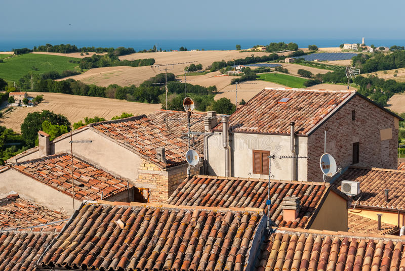 Roofs of ancient houses in the town of Mondolfo, near Pesaro Marche, Italy stock photo