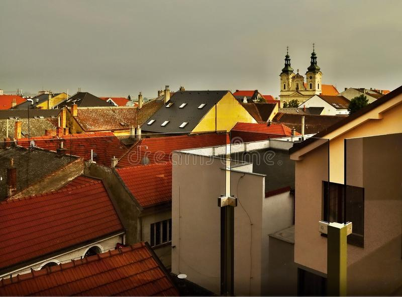 Roofs,buildings, church at sunset in Uherske Hradiste. Panorama of roofs, buildings and church of Saint Francis Xavier at nice warm sunset in city Uherske royalty free stock photos