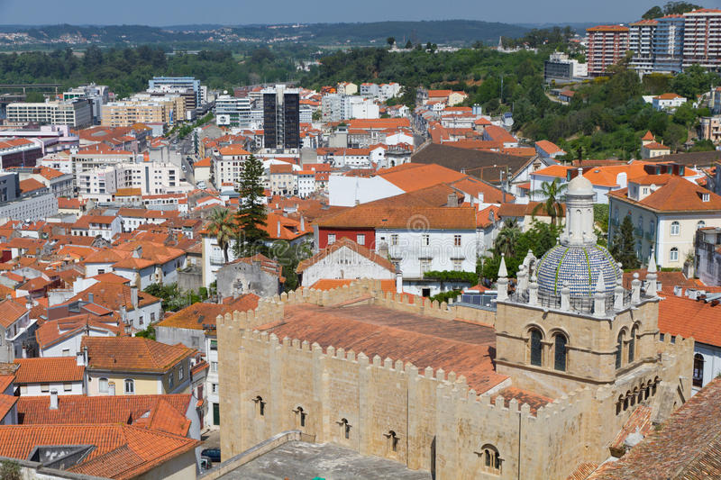 Roofs of Coimbra. Cityscape over the roofs of Coimbra with mighty cathedral se velha de Coimbra, Portugal royalty free stock photo