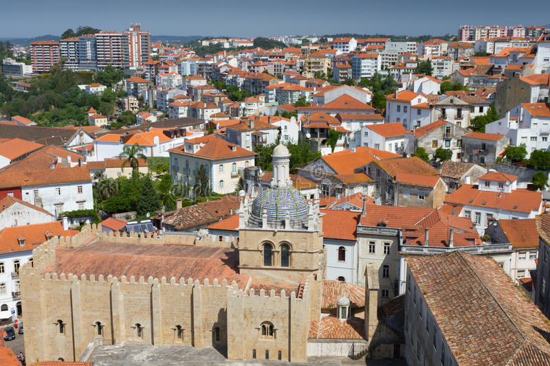 Roofs of Coimbra. Cityscape over the roofs of Coimbra with mighty cathedral se velha de Coimbra, Portugal royalty free stock photography