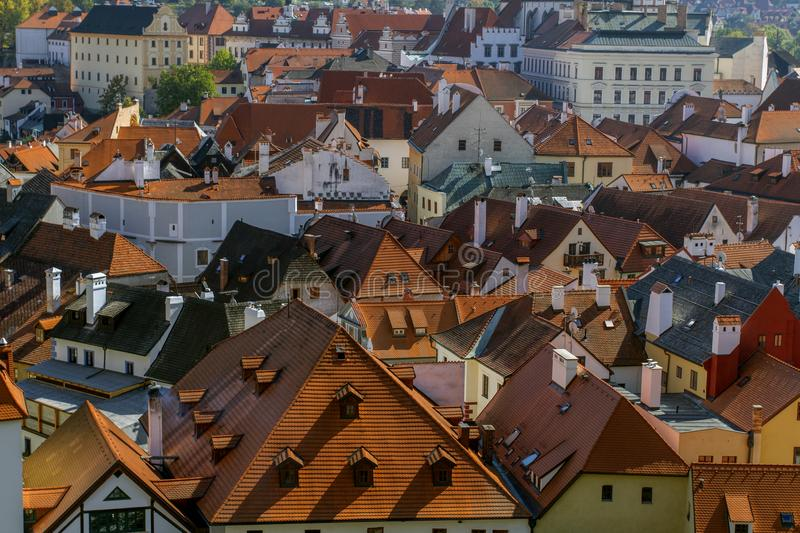 Roofs constructed with red tiles in the old city Cesky Krumlov. stock image
