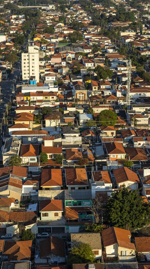 Roofs different from houses. View of the different red roofs of houses royalty free stock photo