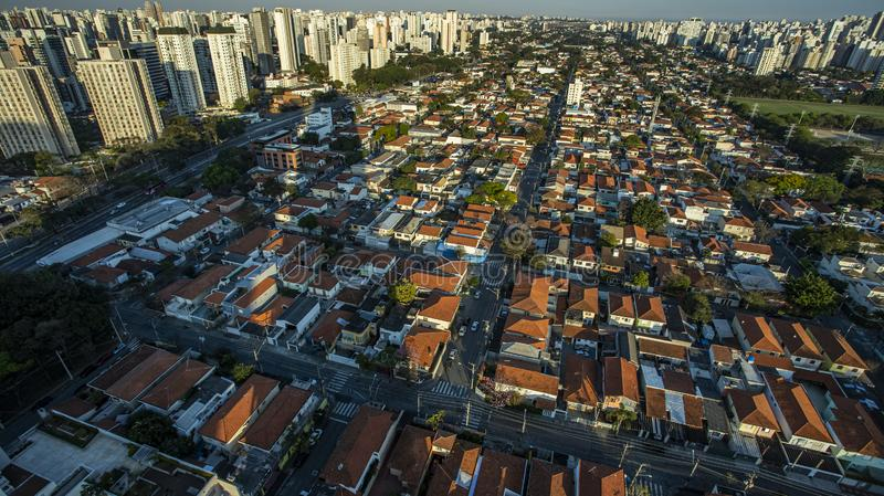 Roofs different from houses. View of the different red roofs of houses stock photography