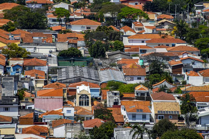 Roofs different from houses. View of the different red roofs of houses royalty free stock image