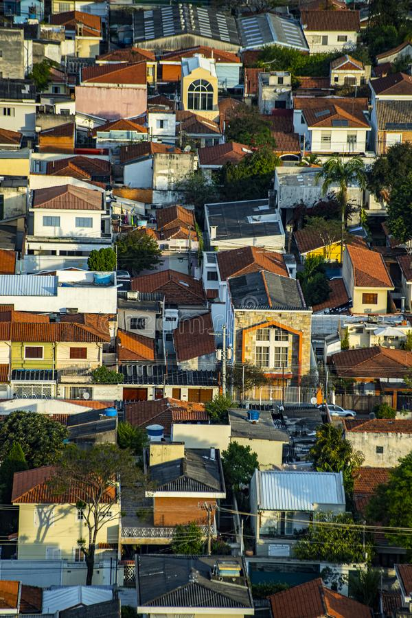 Roofs different from houses. View of the different red roofs of houses royalty free stock photography