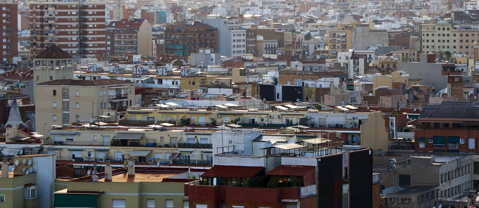 Roofs and houses of Barcelona. Generic view of various housing in Barcelona, Spain, July 2016 royalty free stock photo