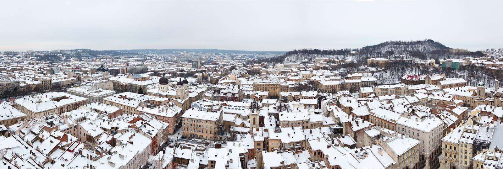 Roofs of Lviv, Ukraine - January 26, 2012. Wine panorama over Lvov city on snpowy winter day. Old historical downtown royalty free stock image