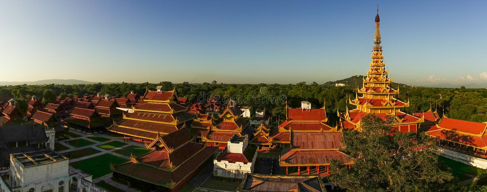 Roofs of Mandalay Palace. Aerial view over the Mandalay Palace Area at eraly sunset stock photo