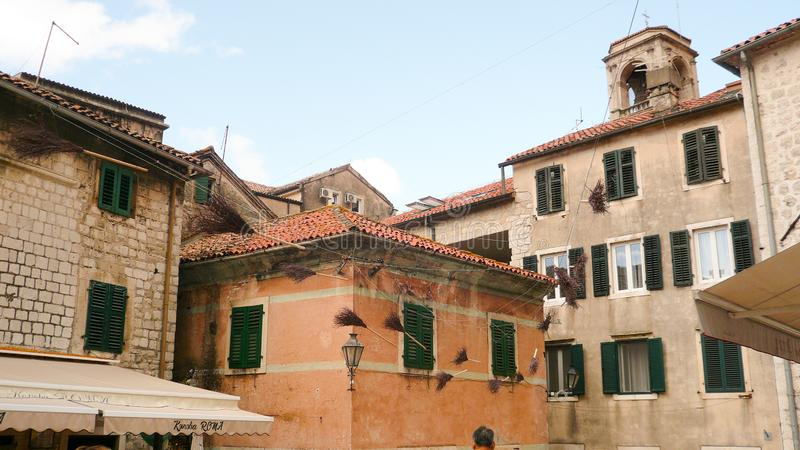 Roofs of old houses. Kotor. Montenegro. Hanging brooms stock photography