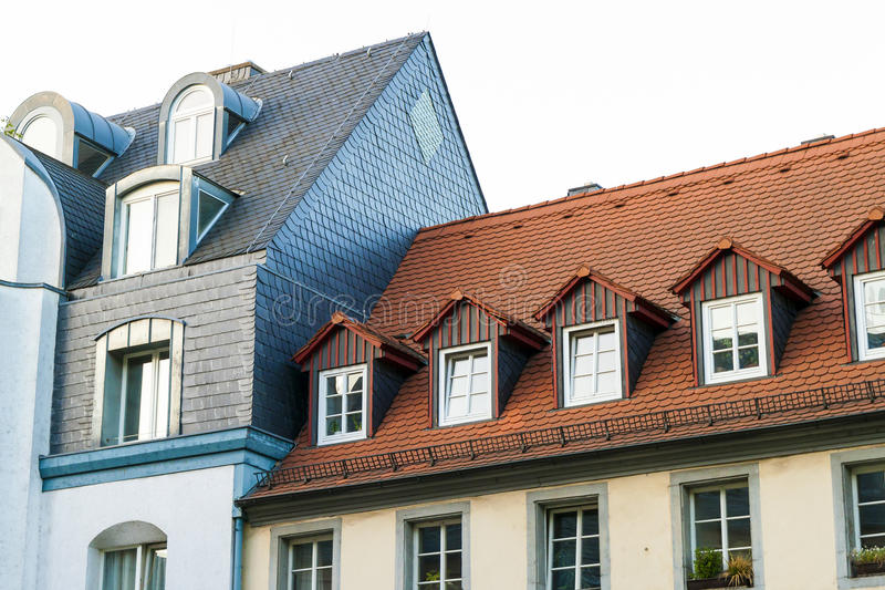 Roofs of old houses with roof windows and orange roof tiles in G stock photo