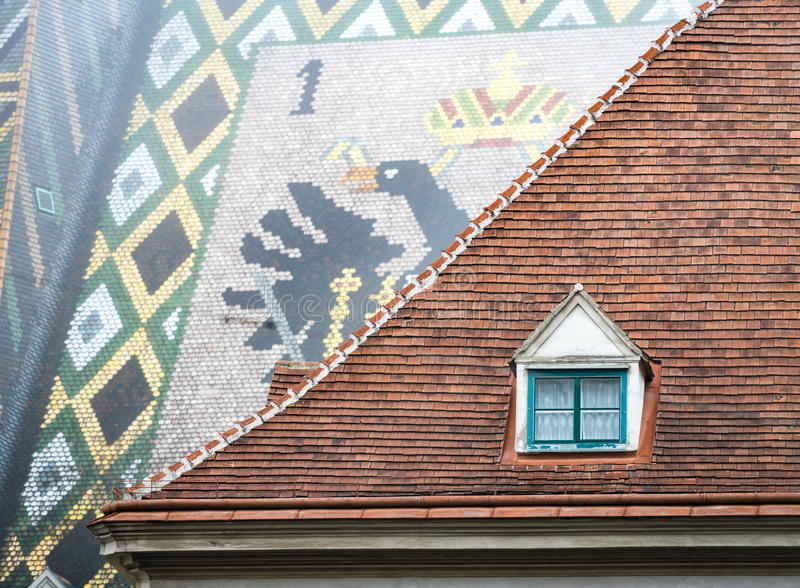 Roofs of old town house and Stephansdom in Vienna. View on roofs of old town house and St. Stephen cathedral. Scene from Vienna, Austria. Europe travel royalty free stock photography