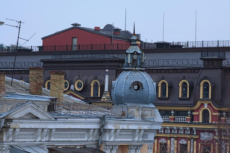 Roofs of old vintage apartment buildings with TV antennas and other devices in downtown of Kyiv, Ukraine.  stock image