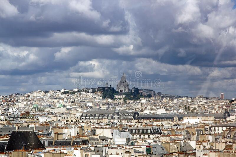 The roofs of Paris under a stormy sky. Paris France royalty free stock image