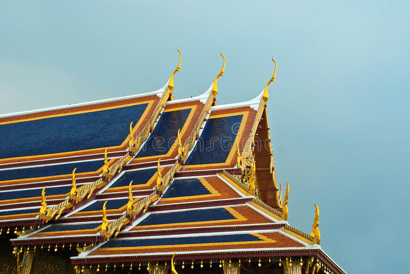 Roofs of Wat Phra Kaeo. Excerpt roofs, indoor traditional roof tiles, in a Buddhist shrine, Wat Phra Kaeo in Bangkok, Thailand royalty free stock photo