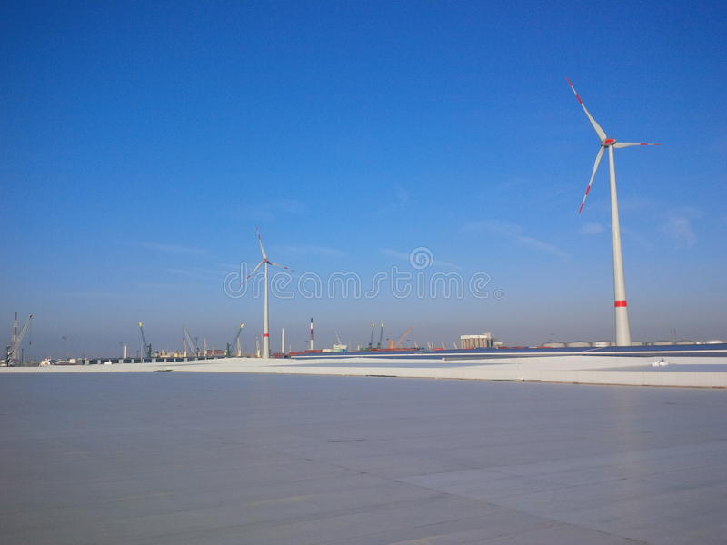 Rooftop with big wind turbines royalty free stock photo