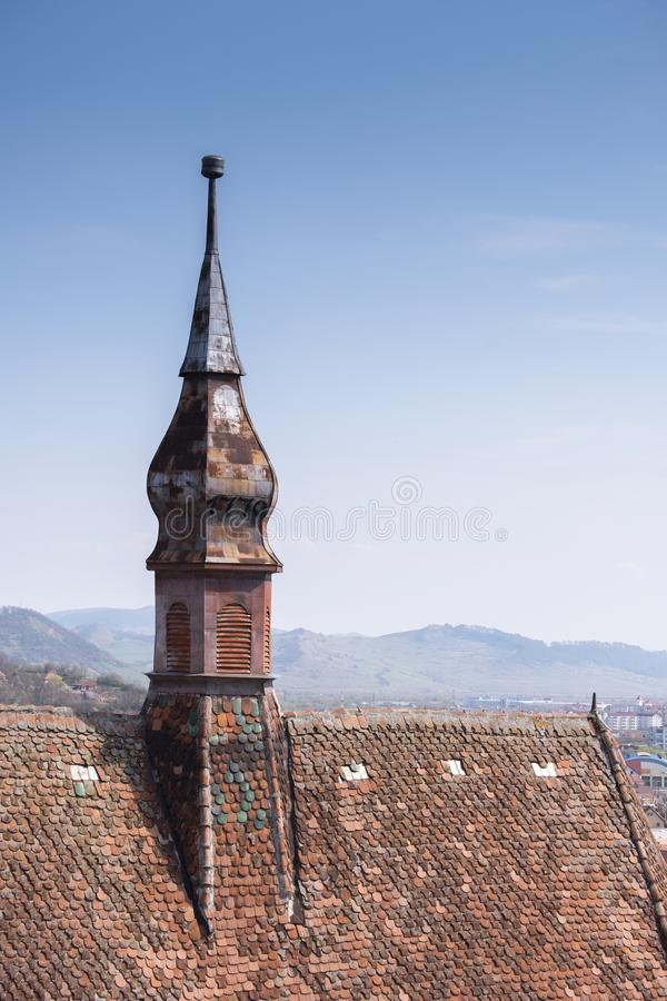 Rooftop of the Church of the Dominican Monastery in Sighisoara. Vertical shot royalty free stock photo