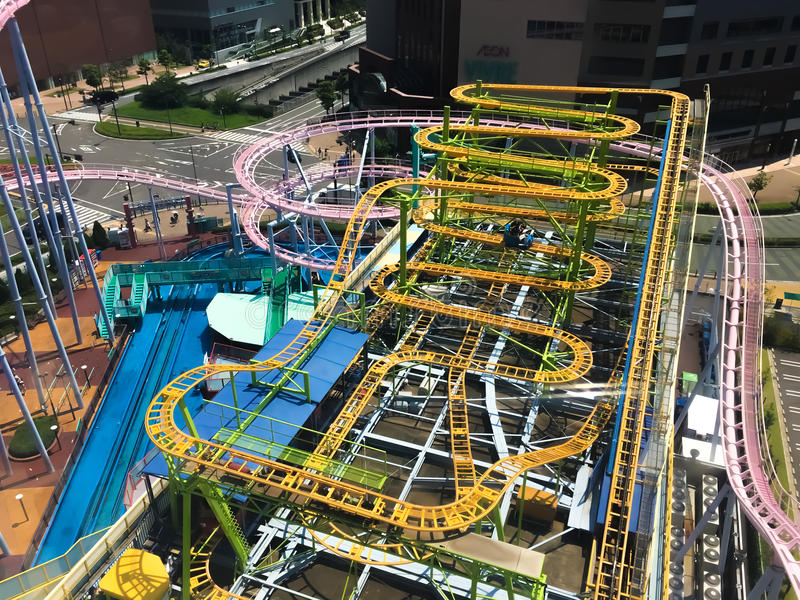 Rooftop Coaster ride. It& x27;s not the plunges but the hairpin turns while perched on a rooftop 6 floors high stock photos