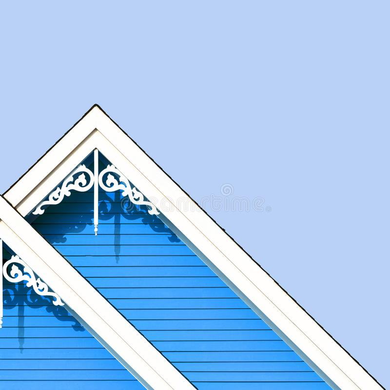 Rooftop detail with decorative fretwork. Detail of the gingerbread style fretwork of the typical wooden houses of Iles de la Madeleine, or the Magdalen Islands royalty free stock image