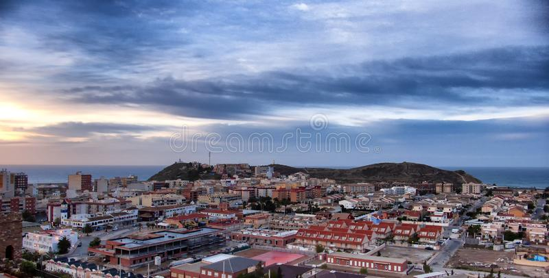 Rooftop landscape of Spanish town at sunrise royalty free stock photos