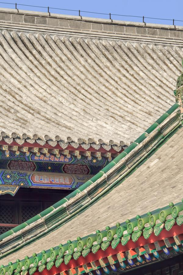 Rooftop of an ornamented pavilion at Yonghe Lamasery, also known as Lama Temple, Beijing, China stock images