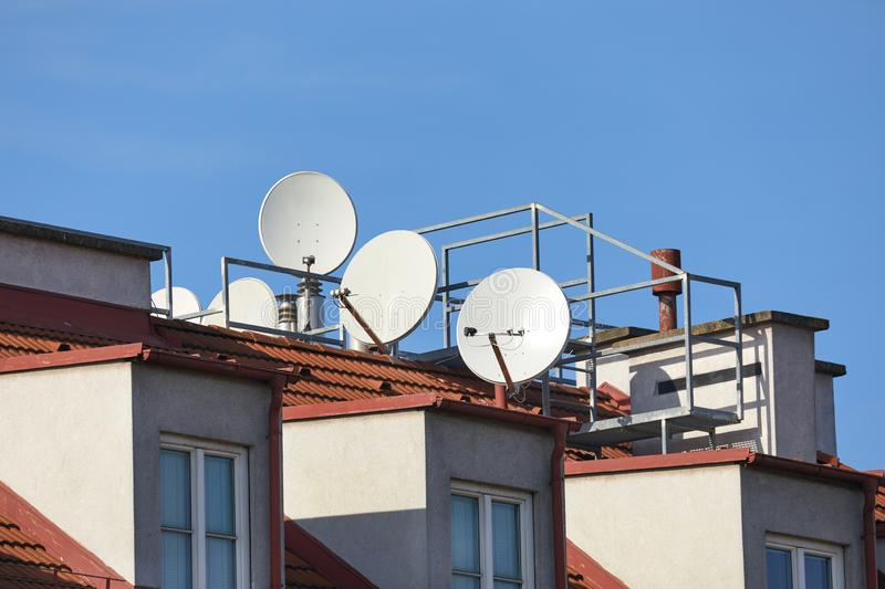Rooftop Parabola Satellite Receivers stock photo