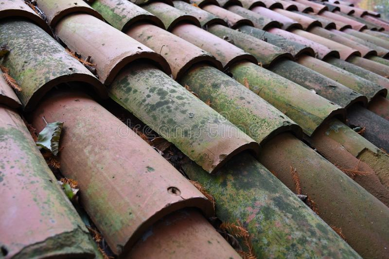 Rooftop. Roof roof tile tile duct romanic novel round cavity mediterranean provencal provence blanket land cooked clay building house villa hillside runoff royalty free stock photos