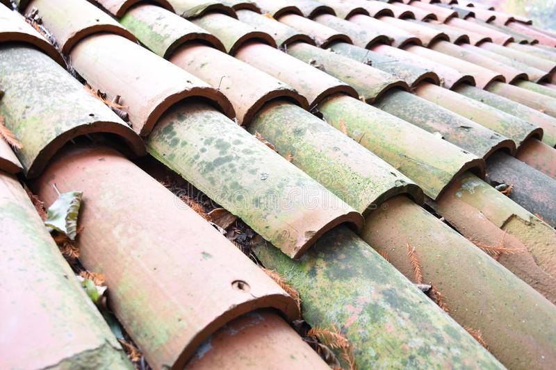 Rooftop. Roof roof tile tile duct romanic novel round cavity mediterranean provencal provence blanket land cooked clay building house villa hillside runoff stock images