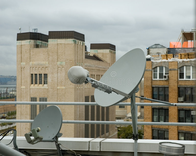 Download Rooftop Satellite Dishes stock image. Image of television - 316857