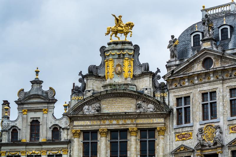 Rooftop sculptures of opulent buildings at Grand Place, Brussels City, Belgium. Brussels, Belgium.  royalty free stock image