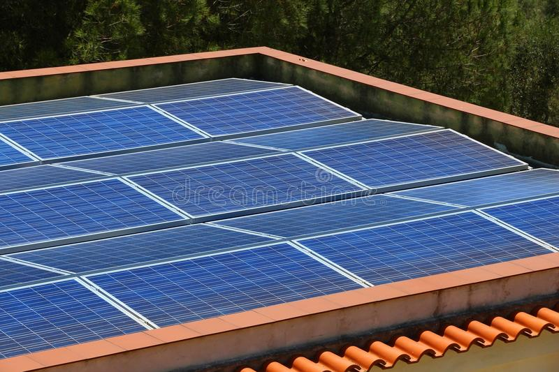 Rooftop solar electricity royalty free stock photography
