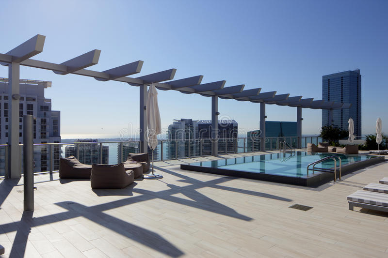 Rooftop swimming pool in the city. Stock image of a rooftop swimming pool in a condo building in the city royalty free stock photos