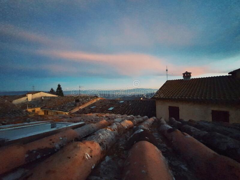 Rooftop of the tuscany house, view of sunset at the rooftop in Cortona, Italy stock photo