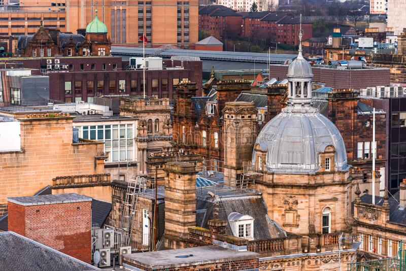 A rooftop view of the mixed architecture of old and new buildings in Glasgow city, Scotland. A rooftop view of the mixed architecture of old and new buildings in stock image