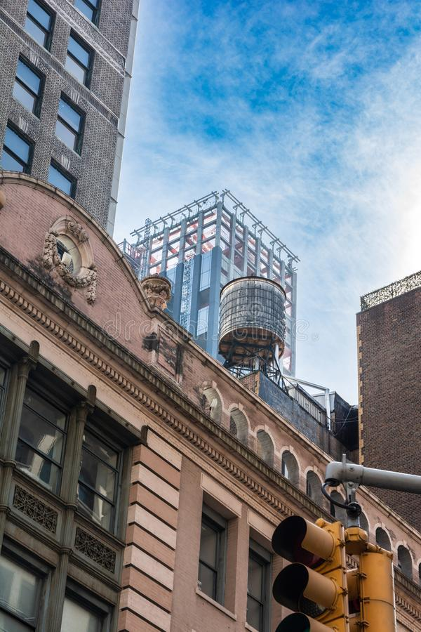 Rooftop water tank in Manhattan, NYC royalty free stock photo