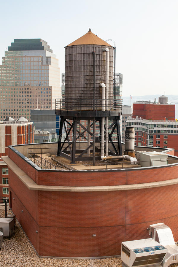 Rooftop Water Tower on NYC Buildings. This is a picture of a New York City water tower. This are placed on roofs of high rise buildings in New York to help in royalty free stock photo
