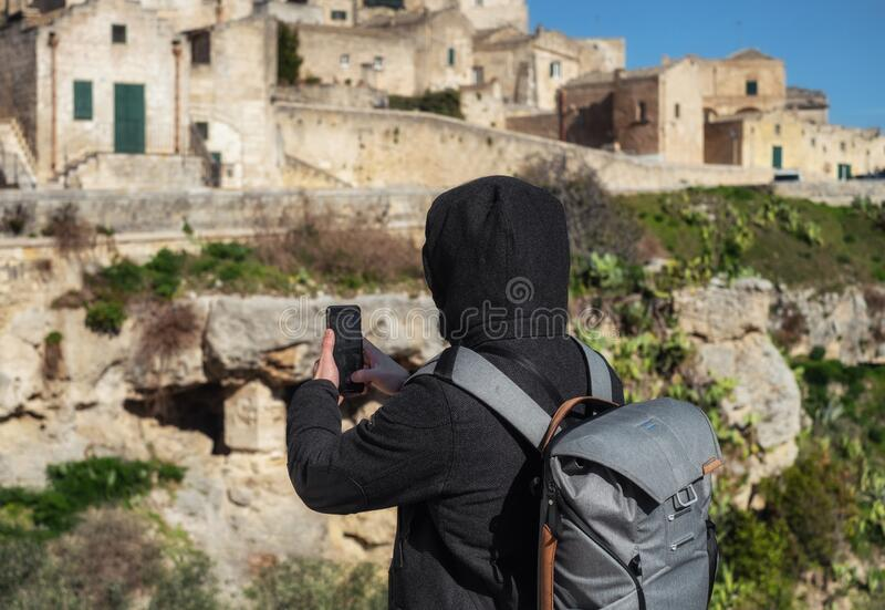 Photographer taking pictures of beautiful Matera town, Italy stock photography