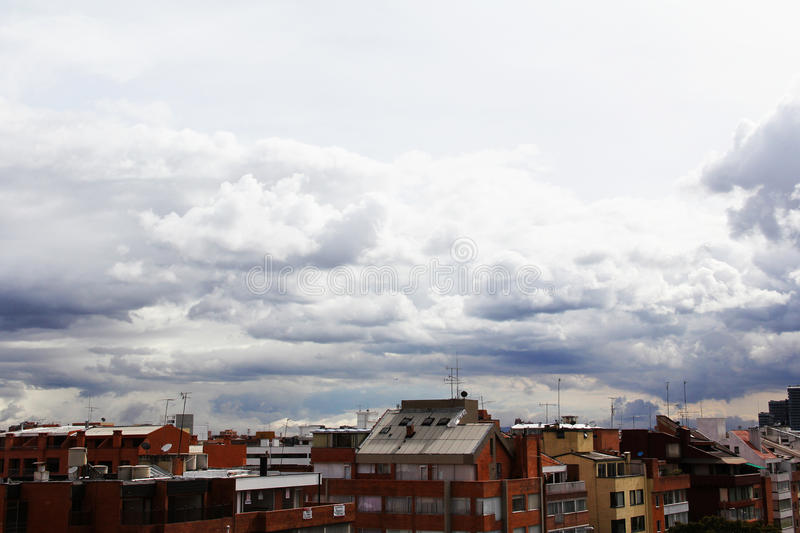 Rooftops and cloudy sky royalty free stock photo