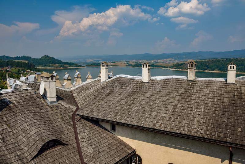 Rooftops and funnels of Niedzica Castle in Southern Poland. Rooftops and funnels of medieval Niedzica Castle on Dunajec river, Southern Poland. Artificial stock photo