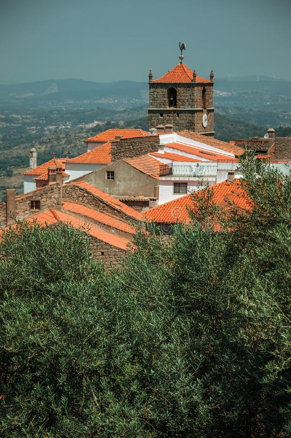 Old stone houses with church steeple and olive tree in Monsanto royalty free stock photo