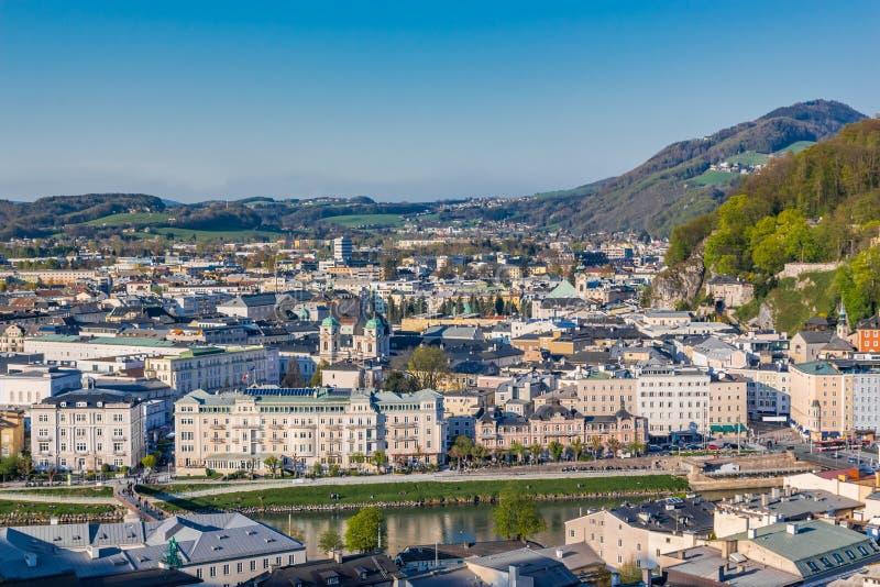 Salzburg Village Rooftops on Hills Background royalty free stock image