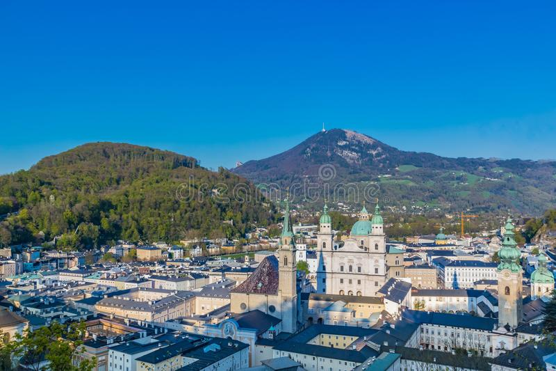 Salzburg Village Rooftops on Hills Background royalty free stock photos