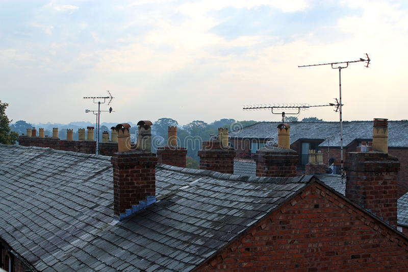 Rooftops. Of a row of terraced houses showing chimneys and TV aerials stock images